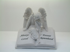 6156 - Angel sitting on a Book