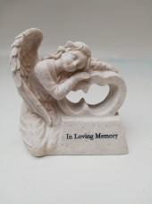 Angel lying on heart